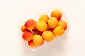 peaches in plastic packaging from a supermarket.