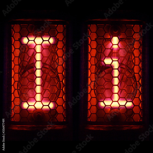 Foto Nixie tube indicator set of letters the whole alphabet