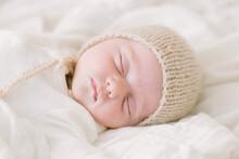 Newborn Baby In Knit Bonnet Sl...