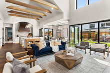 Living Room And Kitchen Interior In New Luxury Home With Large Windows
