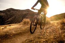 Woman Mountain Biking During S...