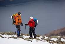 Couple Hiking Up Helvellyn Mou...
