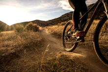 Young Woman Mountain Biking Du...