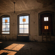 A View Of The Statue Of Liberty Through The Window In An Abandoned Hospital Room On Ellis Island.
