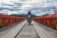 Man On Off Road Touring Motorbike Crossing Wooden Bridge