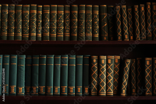 Photo Old books on an archival shelf of library of storehouse