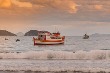 Fishing Boats In The Sea At Dusk, Slightly Choppy Sea With Colorful Clouds
