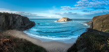 Breathtaking Panorama Of Rocky Coastline With Sandy Area And Cliff In Sea In Sunny Summer Day