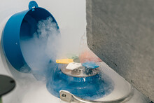 Nitrogen Liquid Splashing From A Cryogenic Tank Container With Frozen Egg Cells And Embryos In Fertility Clinic