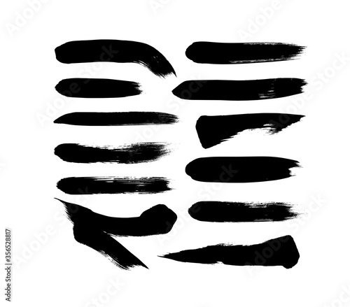 Fototapeta Vector grungy paint brush strokes collection. Calligraphy straight smears, stamp, lines. obraz