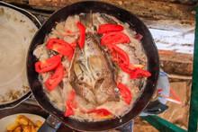 Cooking Fish In A Pan. Peru