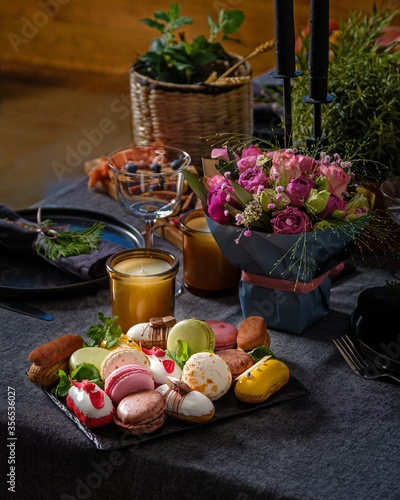 Romantic dinner concept with sweets and candles on a table