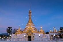 View Of Golden Pagoda With Blu...