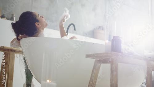 Canvastavla Close up sensual woman blowing foam