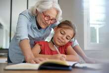 Grandmother Helping Grandkid W...