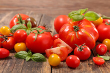 Assorted Of Colorful Variety Of Tomatoes And Basil