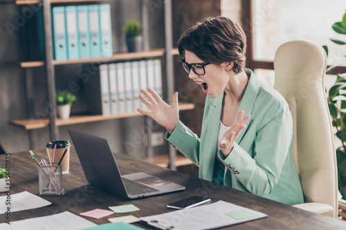 Valokuva Angry frustrated depressed secretary girl agent marketer sit desk chair work lap