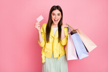 Photo Of Pretty Lady Choosing Clothes Hold Many Shopping Packs Plastic Bonus Card Buying New Collection Wear Trend Yellow Leather Jacket Skirt Isolated Pastel Pink Color Background