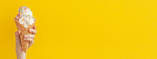 Child Holding A Vanilla Ice Cream Cone On A Bright Yellow And Blue Background. Banner