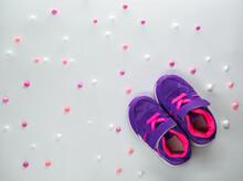 Flatlay Of Violet Pink Childre...