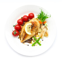 Grill Chicken Breast  Or Chicken Steak With Black Peppers Sauce Topped Black Peppers Decorate Asparagus,oyster Mushroom,tomato And Lemon Carved Style  Top View Isolated On White Background