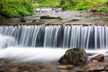 Small Stream Waterfall On Spring Forest. Nature Background. Landscape Photography
