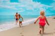 Leinwandbild Motiv happy kids enjoy beach vacation, boy and girls have fun