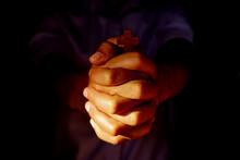 Human Hand Holding The Cross B...