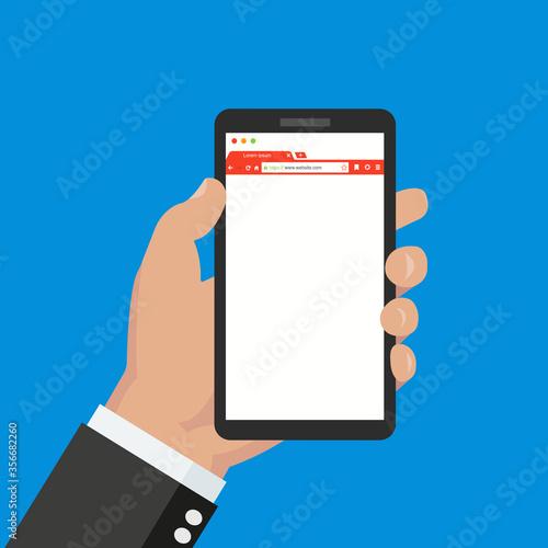 Fotografía Man holding smartphone in hand