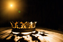 The Crown On A Black Background Is Illuminated By A Golden Beam. Low-key Image Of A Beautiful Queen / Royal Crown Vintage Is Filtered. Fantasy Of The Medieval Period. Game Of Thrones.
