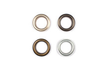 Four Brass Multicoloured Metal Eyelets Or Rivets - Curtains Rings For Fastening Fabric To The Cornice, Isolated On White. With Copyspace For Text For Your Presentation