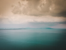 Clouds Over The Sea And The St...