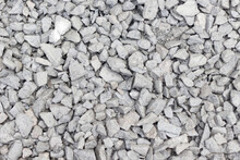 Gray Pebbles Background. Top View, Copy Space, Texture