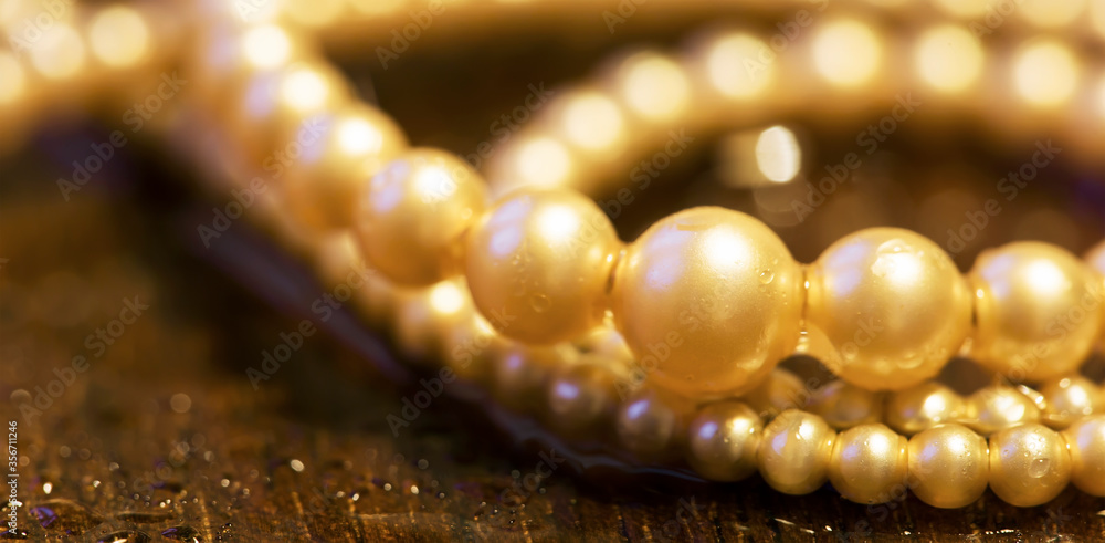 Fototapeta White pearls, female gift jewelry necklace on brown background. Closeup, web banner.
