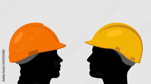 Foto People in construction helmets