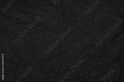 Fotografia, Obraz Rumpled embossed closeup napkin texture. Black background