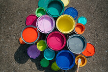 Cans Of Colorful Paint On Pave...