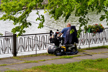 Person With Reduced Mobility Using A Personal Mobility Scooter. Disabled Fishing. Improving The Quality Of Life