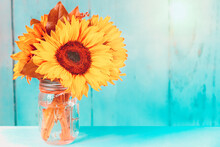 Glowing Sunflowers In A Vase W...