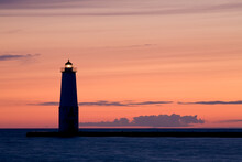 A Lighthouse Silhouette At Sunet