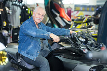 Senior Man In Motorbike Salon