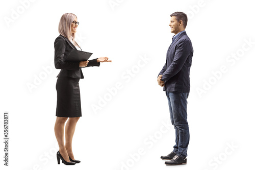 Professional man and woman standing and talking talking