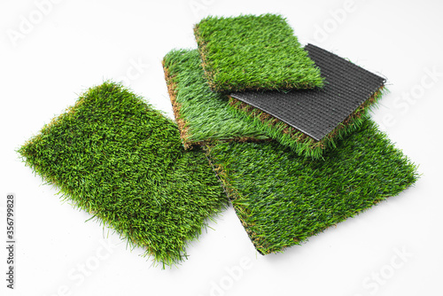 Obraz Detail of types of artificial grass in a sample book. - fototapety do salonu