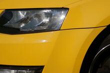 Headlight Of A Yellow Car