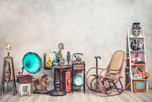 Antique Gramophone, Rocking Chair, Old Typewriter, Retro Radio, Tape Recorder, Projector, Books, Clock, Camera, Fiddle, Mask, Cylinder Hat, Cane, Suitcase, Bow. Vintage Style Filtered Photo