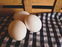 Eggs Captured In Selective Photo On A Farm Themed Background With Wooden Box And Plaid Print