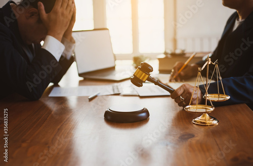 Photo Concepts of lawsuits and bankruptcy decisions.