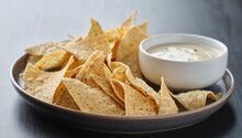 Mexican Hot Queso Blanco Cheese Dip With Corn Tortilla Chips On Plate