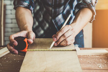 Carpenter Working On Wood Craf...