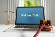 Dividend Yeild – Law, Jurisdiction. A Lawyer Laptop In The Office On Desk. Text On The Screen. Libra And Hammer